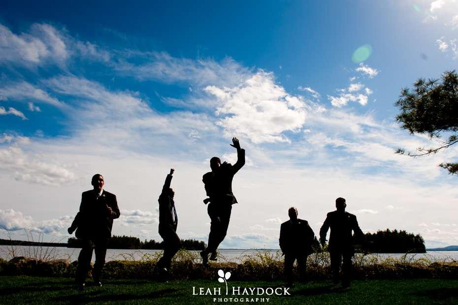 silhouette jumping groomsmen migis lodge wedding photographer