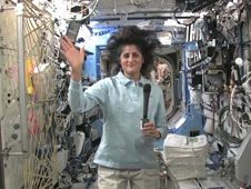 Commander Suni Williams greets reporters<br /> during an in-flight interview from the<br /> Destiny laboratory of the International<br /> Space Station.<br /> Credit: NASA TV