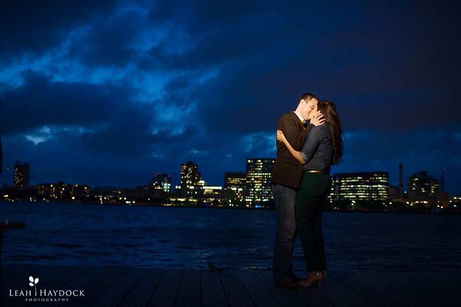 Couple kissing at night with dramatic blue skies on Charles River in Boston