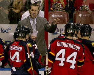Panthers coach Kevin Dineen gives instructions during a timeout in a game against the Buffalo Sabres at BB&T center in Sunrise on Feb. 28, 2013.