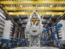 Image above: Technicians attach the Dragon<br /> capsule to a Falcon 9 rocket at the SpaceX<br /> facility at Cape Canaveral Air Force<br /> Station, Fla., during preparations for the<br /> CRS-1 mission.<br /> Photo credit: NASA/Kim Shiflett&nbsp;&nbsp; <br /> <a href='http://www.nasa.gov/images/content/693887main_crs1dragonrotate2_full.jpg' class='bbc_url' title='External link' rel='nofollow external'>� Full image and caption</a>