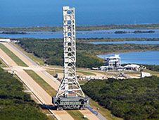 Image above:The mobile launcher made<br /> the 4.2-mile trek along the crawler<br /> way, Nov. 11, 2011, from Launch Pad<br /> 39B to the park site near the Vehicle<br /> Assembly Building at NASA�s Kennedy<br /> Space Center, after a two-week stay<br /> on the pad for structural and<br /> functional engineering tests.<br /> Photo Credit: NASA file/2011&nbsp;&nbsp; <br /> <a href='http://www.nasa.gov/centers/kennedy/images/content/690360main_Mobile%20Launcher-Full.JPG' class='bbc_url' title='External link' rel='nofollow external'>� View Larger Image</a>