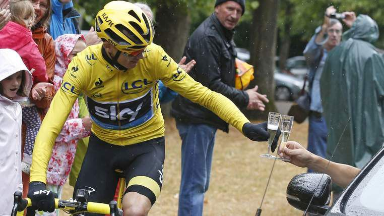 Christopher Froome 2015 Tour de France winner drinks a glass of champagne during the final 21st stage: Team Sky principal Sir David Brailsford, who was driving beside him, handed Chris Froome a glass of champagne to drink as he rode out the closing stages
