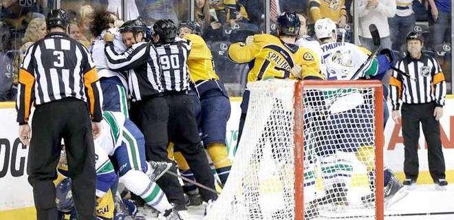 Nashville Predators and Vancouver Canucks are involved in a fight