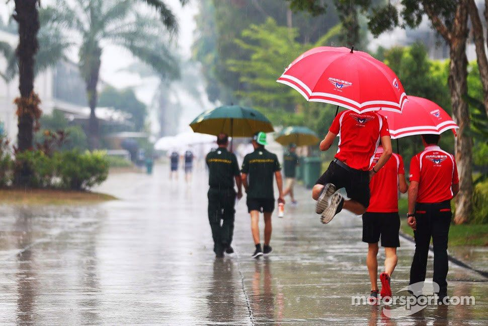 F1 2014, Malaysian GP, Jules Bianchi, Marussia F1 Team in a wet and rainy paddock