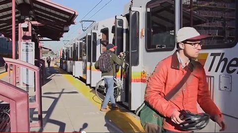 Passenger-carries-bike-on-RTD-train