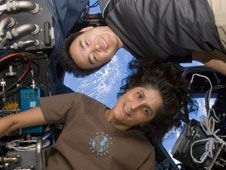 Commander Suni Williams and Flight<br /> Engineer Aki Hoshide pose for a photo<br /> in the cupola of the International<br /> Space Station.<br /> Credit: NASA