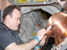 View of Expedition 28 Flight Engineer<br /> Ron Garan applying copper tape to<br /> exposed activation ports on the<br /> ReEntry Breakup Recorder (REBR) prior<br /> to installation in the Automated<br /> Transfer Vehicle-2 (ATV-2). (NASA)&nbsp;&nbsp; <br /> <a href='http://www.nasa.gov/images/content/695925main_rebr1_XL.jpg' class='bbc_url' title='External link' rel='nofollow external'>View large image</a>