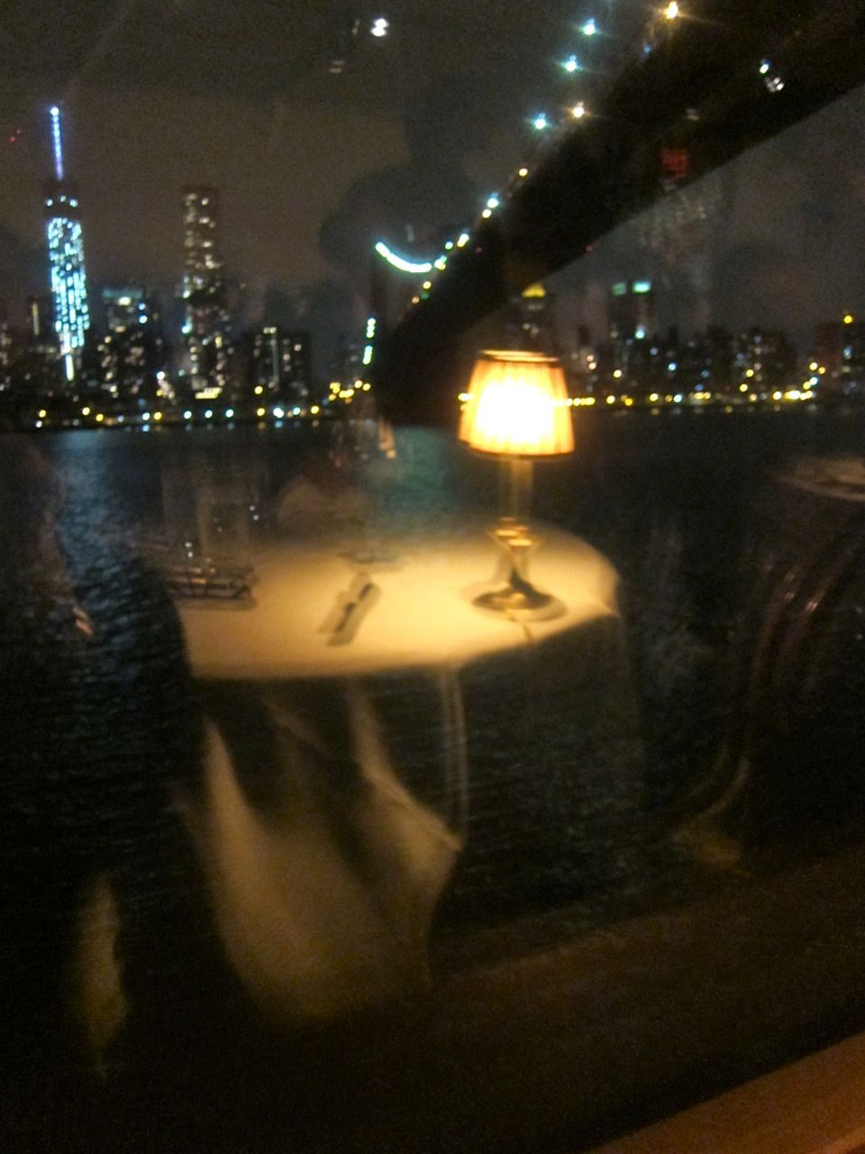 Our table reflected in The River Café window looking out at the jeweled towers.