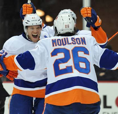 Kyle Okposo (left) scores the game-winner with 7:37 left in the game to cap New York