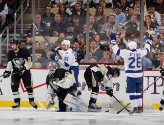 PITTSBURGH, PA - MARCH 4: Steven Stamkos #91 of the Tampa Bay Lightning reacts to his goal with Martin St. Louis #26 in front of Marc-Andre Fleury #29 and Joe Vitale #46 of the Pittsburgh Penguins on March 4, 2013 at Consol Energy Center in Pittsburgh, Pennsylvania. (Photo by Gregory Shamus/NHLI via Getty Images)