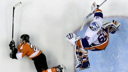 New York Islanders Kevin Poulin, right, leaps over Philadelphia Flyers Claude Giroux in the second period of an NHL hockey game, Thursday, April 25, 2013, in Philadelphia. (AP Photo/Matt Slocum)