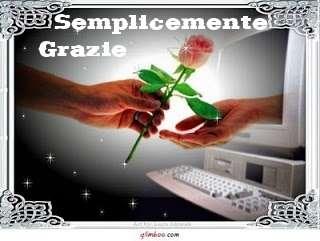 mano che dona un fiore ad una mano che esce dal compiuter