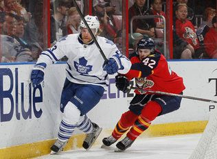 SUNRISE, FL - APRIL 25: Mike Kostka #53 of the Toronto Maple Leafs and Mike Weaver #43 of the Florida Panthers skate after a loose puck during first-period action at the BB&T Center on April 25, 2013 in Sunrise, Florida. (Photo by Joel Auerbach/Getty Images)