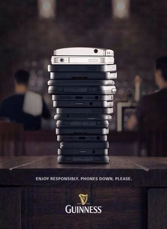Enjoy responsibly. Phones down, please. Guinness.