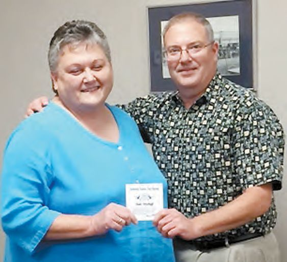 HONORED…SWOSU Support Personnel Organization President Kirk Fast congratulates Linda Woodruff on 35 years of service to SWOSU-Sayre. (Photo provided