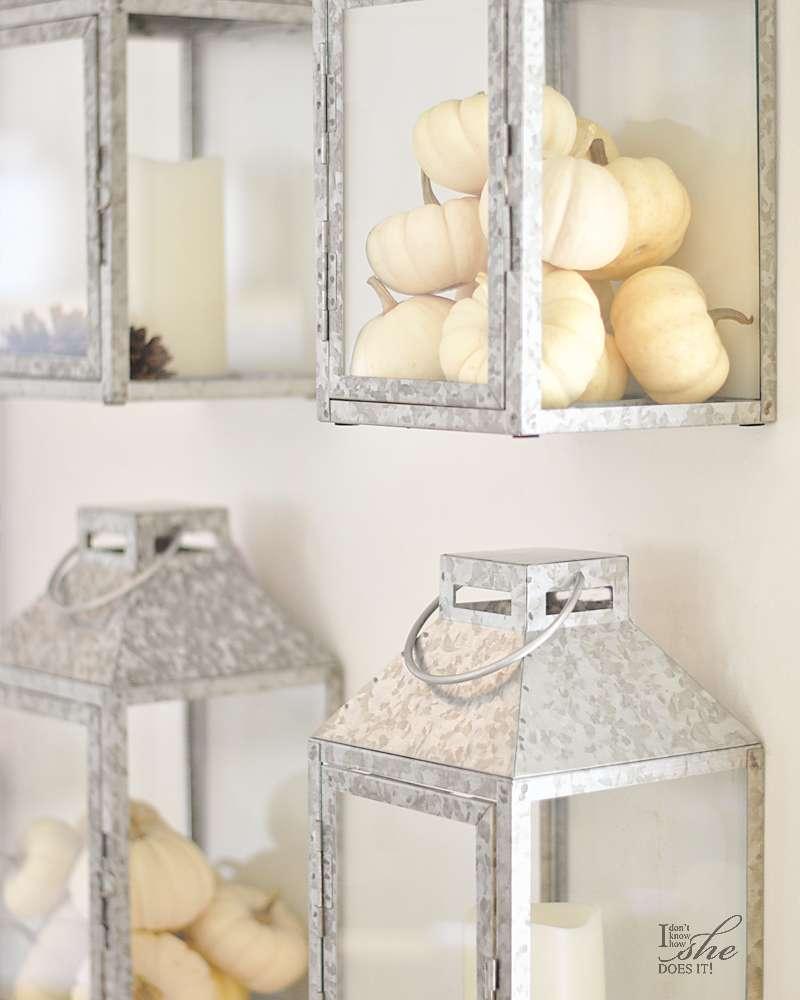 Lanterns filled with mini pumpkins