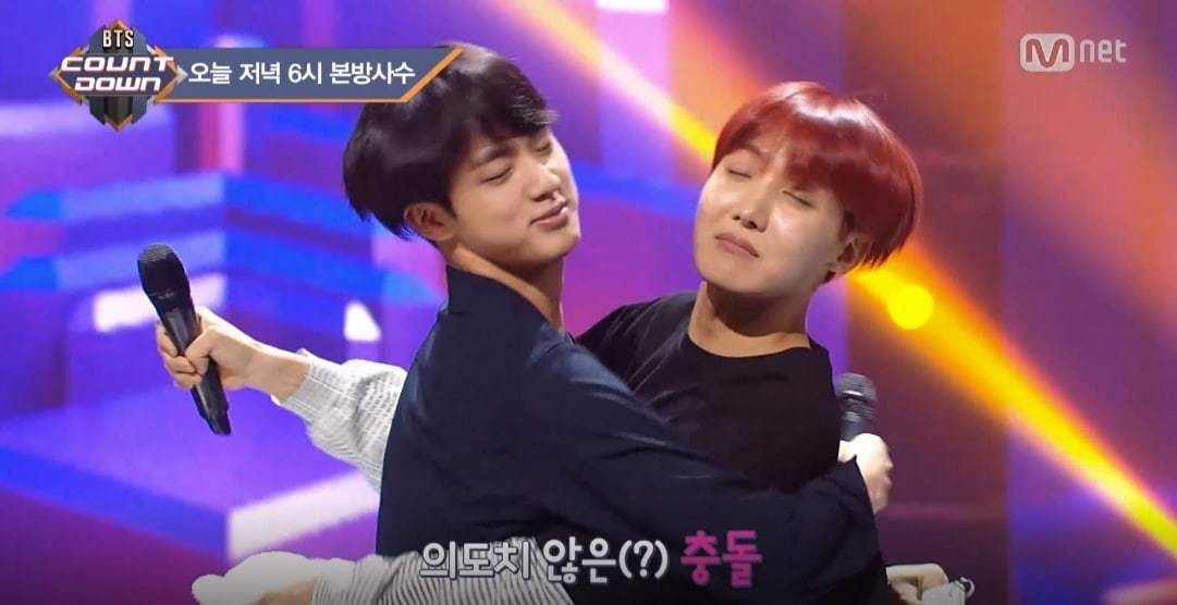 "Watch: BTS's Jin And J-Hope Experience An Unwanted ""Kiss"""