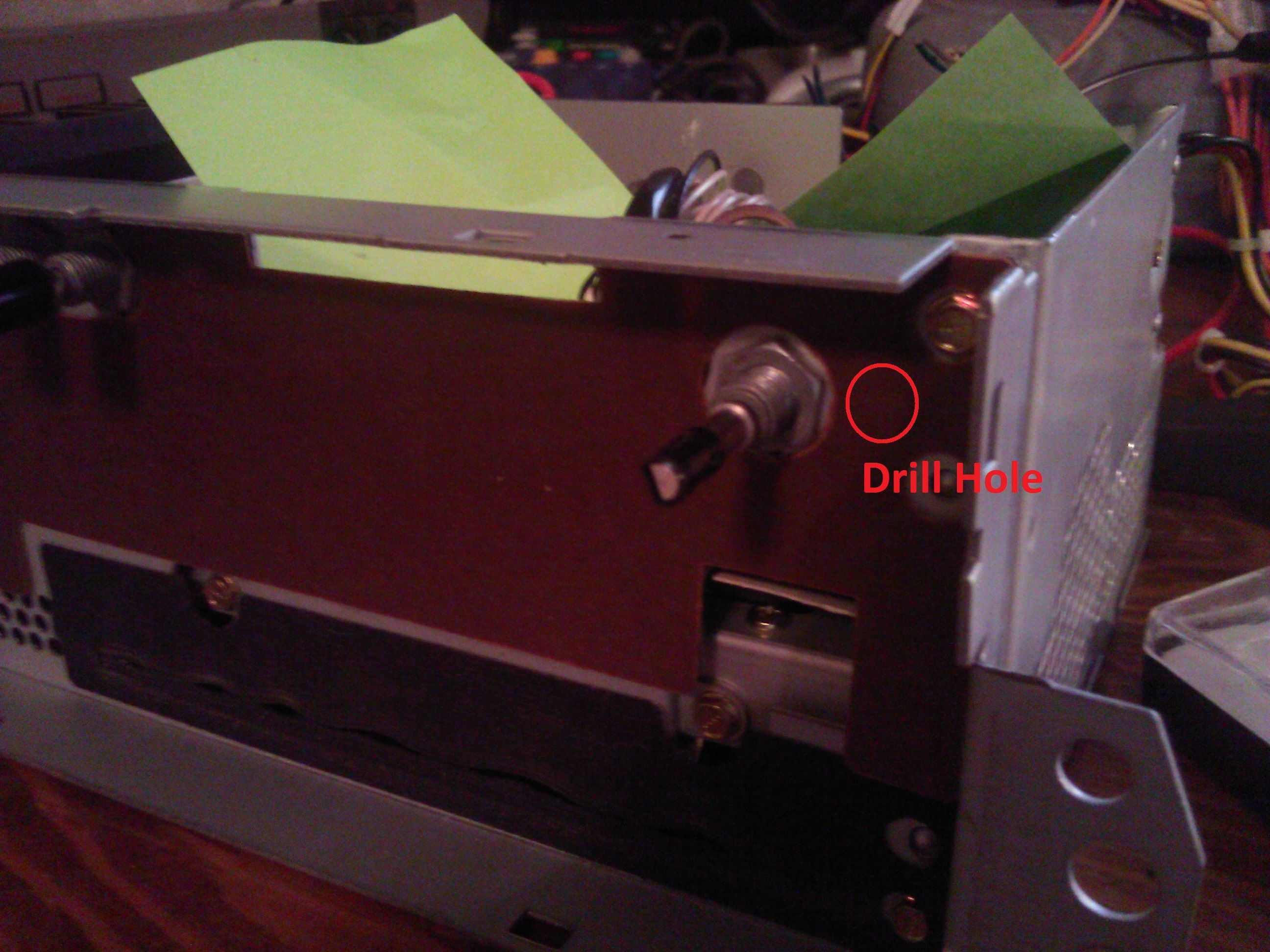 then, you must take out some of the support material behind the plastic  faceplate to fit the port inside, along with drilling a hole and cutting  the metal