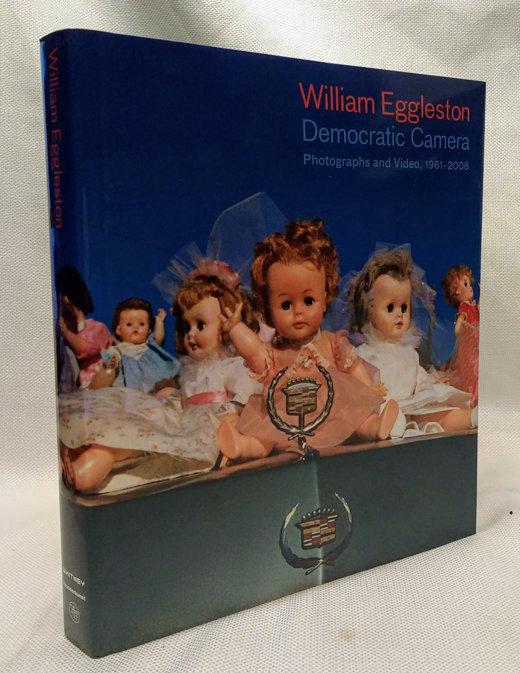 William Eggleston: Democratic Camera, Photographs and Video, 1961-2008 (Whitney Museum of American Art), Sussman, Elisabeth; Weski, Thomas; Kukielski, Tina [Contributor]; De Salvo, Donna [Contributor]; Booth, Stanley [Contributor];