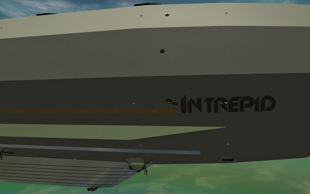 My Adventures In SketchUp - Intrepid: A Revolution In Design - A Close-Up RCT3 Screenshot Alongside Intrepid In The Vicinity Of It's Branding. The Viewer Is Alongside Starboard Looking Port.