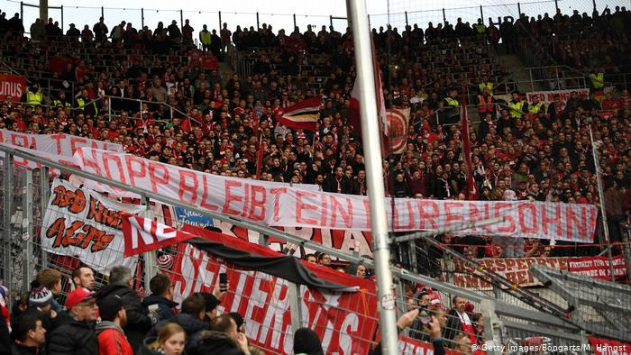 "Hoffenheim vs. Bayern Munich has been interrupted after some away team supporters insistently displayed ""Hopp bleibt ein du hurensohn!"" plus other banners insulting Hoffenheim benefactor Dietmar Hopp"