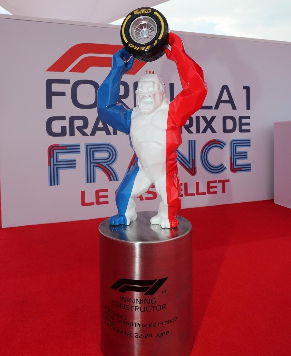 F1 2018 French GP Paul Ricard Le Castellet Grand Prix de France Winning Constructor Trophy Mokey Holding a Pirelli F1 Tyre