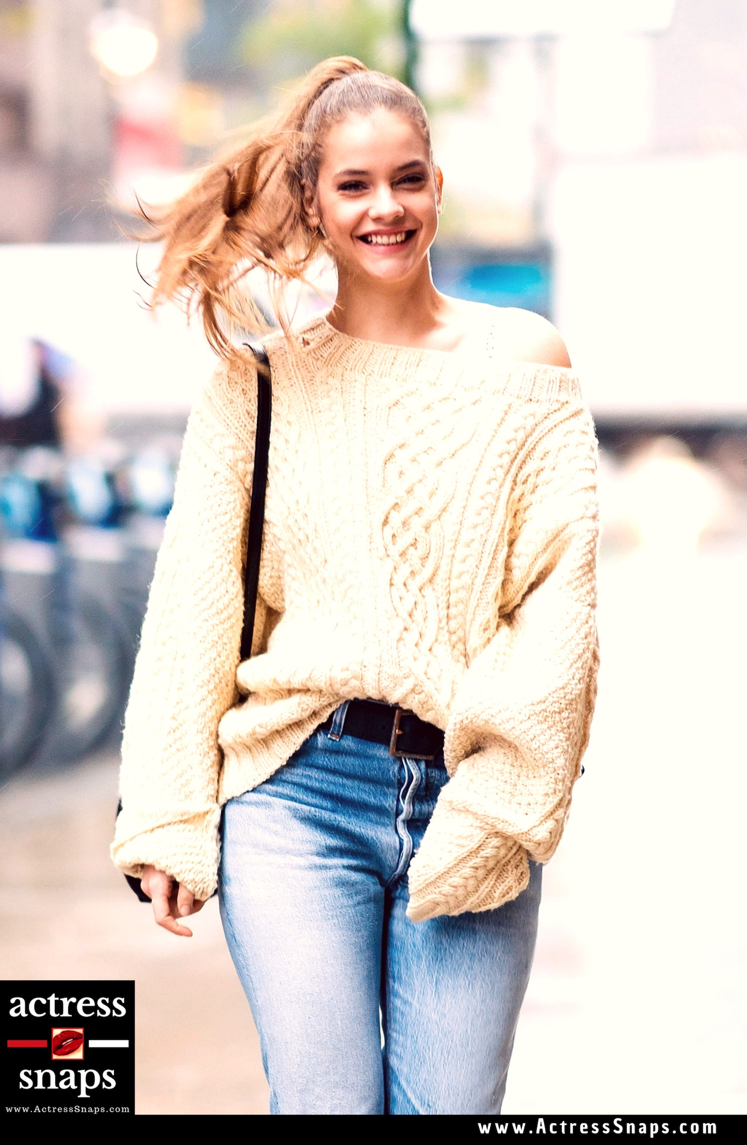 Super Model Barbara Palvin looking cheerful weraing a cream sweater