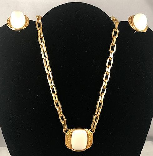 f45b29f622a The set features a rich matte gold finish with white or ivory colored  cabochon insets.